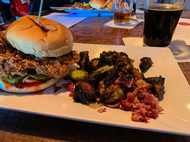 The Motherclucker sandwich and brussels sprouts at Feed & Table Tavern in Chattanooga