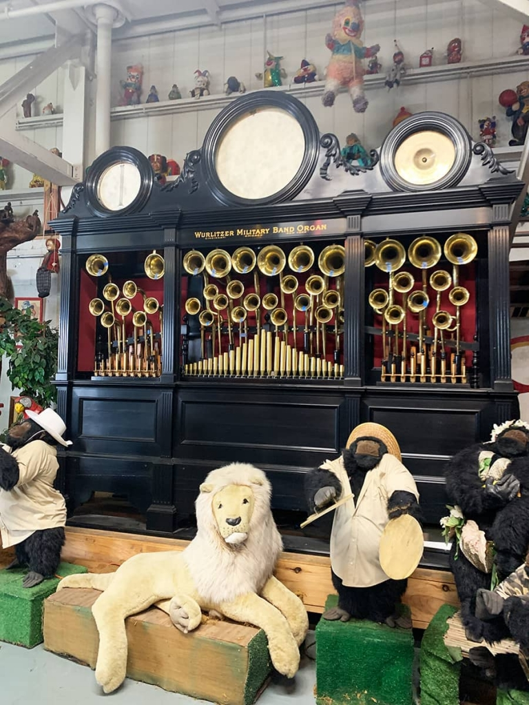 Black Wurlitzer band organ with stuffed animals in front inside The American Treasure Tour